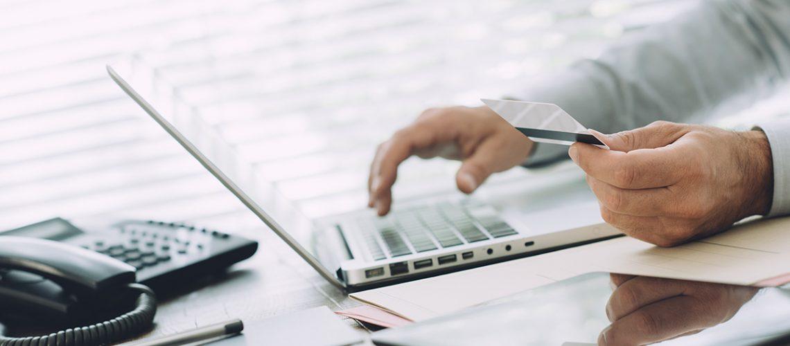 businessman-doing-online-banking-PFEWLTW