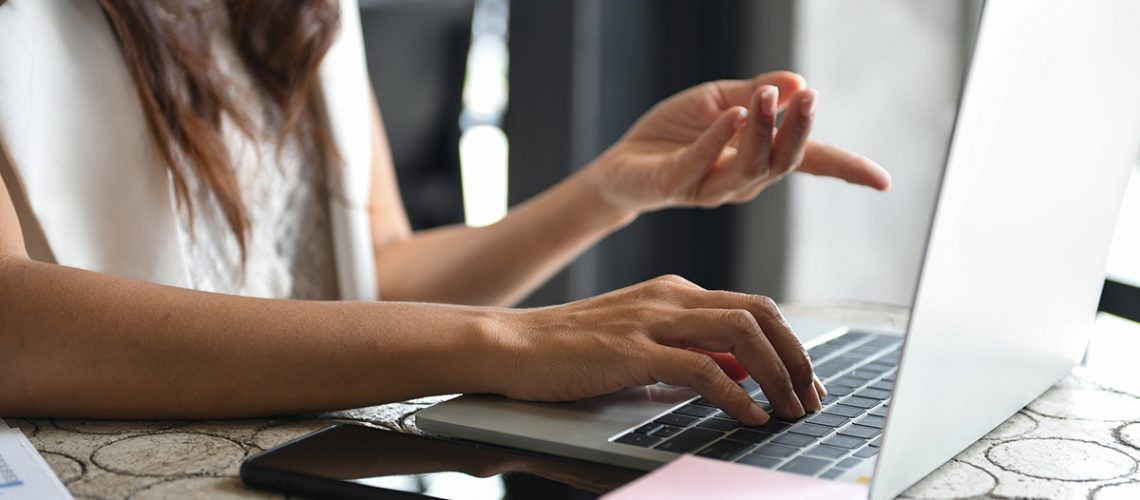 cropped-shot-of-a-businesswoman-using-a-laptop-and-GPKNFKV