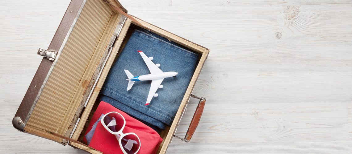 suitcase-airplane-clothes-and-travel-accessories-49RRP2M